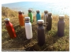 colors-bottles-with-loop-carry-by-the-beach