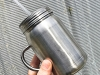 Stee-Mason-Jar-With-Handle-In-Hand