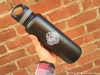 40-oz-insulated-bottle-black-skull-logo-handheld
