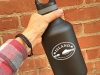 64-oz-insulated-bottle-black-in-hand